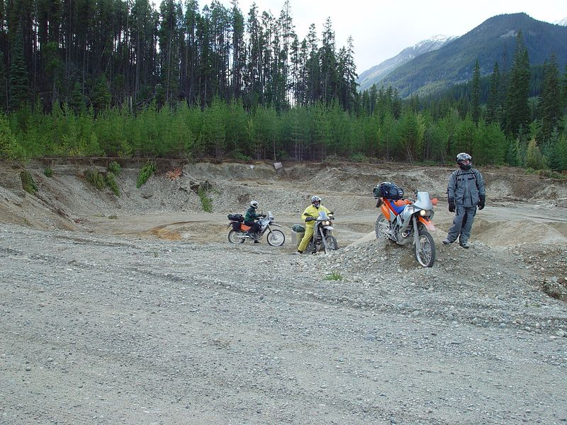 KTM's playing in a gravel pit.