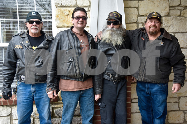 Bert smith, Rob Kandler, Greg Kludt and Egor Leet pose for a photo at Brookdale Tyler East Senior Living in Tyler, Texas, on Thursday, March 1, 2018. Kludt was an avid motorcyclist in his earlier years and one of his last wishes was to ride a motorcycle again. Joey Allen drove Kludt in his sidecar and many motorcyclists accompanied them. (Chelsea Purgahn/Tyler Morning Telegraph)