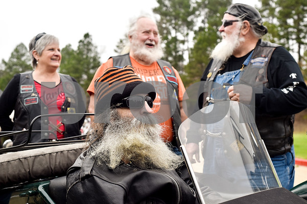 Greg Kludt, bottom center, sits in the sidecar of a motorcycle as other motorcyclists stand around him at Brookdale Tyler East Senior Living in Tyler, Texas, on Thursday, March 1, 2018. Kludt was an avid motorcyclist in his earlier years and one of his last wishes was to ride a motorcycle again. Joey Allen drove Kludt in his sidecar and many motorcyclists accompanied them. (Chelsea Purgahn/Tyler Morning Telegraph)