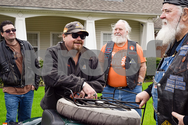 Rob Kandler, Egor Leet, Woody Weimer and Joey Allen stand around Allen's motorcycle and chat at Brookdale Tyler East Senior Living in Tyler, Texas, on Thursday, March 1, 2018. Kludt was an avid motorcyclist in his earlier years and one of his last wishes was to ride a motorcycle again. Allen drove Kludt in his sidecar and many motorcyclists accompanied them. (Chelsea Purgahn/Tyler Morning Telegraph)