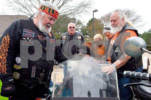 """""""Preacher Don"""" prays over Greg Kludt, center, as Woody Weimer rests his hand on Kludt's shoulder at Brookdale Tyler East Senior Living in Tyler, Texas, on Thursday, March 1, 2018. Kludt was an avid motorcyclist in his earlier years and one of his last wishes was to ride a motorcycle again. Joey Allen drove Kludt in his sidecar and many motorcyclists accompanied them. (Chelsea Purgahn/Tyler Morning Telegraph)"""
