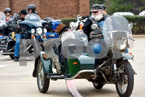 Greg Kludt sits in the side car and fist bumps Joey Allen who is driving the motorcycle at Brookdale Tyler East Senior Living in Tyler, Texas, on Thursday, March 1, 2018. Kludt was an avid motorcyclist in his earlier years and one of his last wishes was to ride a motorcycle again. Allen drove Kludt in his sidecar and many motorcyclists accompanied them. (Chelsea Purgahn/Tyler Morning Telegraph)