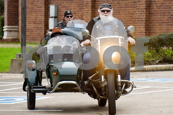 Greg Kludt sits in the sidecar as Joey Allen parks his motorcycle at Brookdale Tyler East Senior Living in Tyler, Texas, on Thursday, March 1, 2018. Kludt was an avid motorcyclist in his earlier years and one of his last wishes was to ride a motorcycle again. Allen drove Kludt in his sidecar and many motorcyclists accompanied them. (Chelsea Purgahn/Tyler Morning Telegraph)