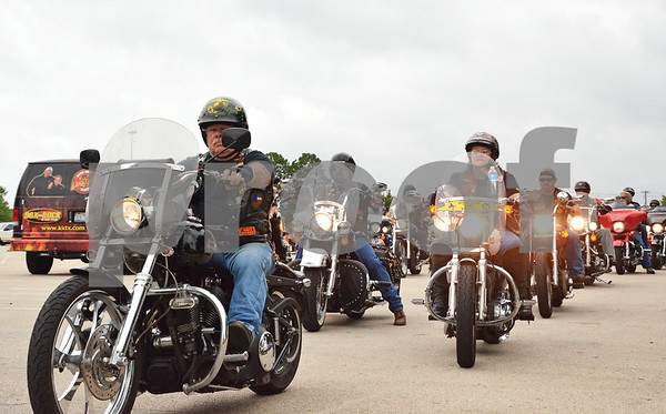 Motorcycles enthusiasts file out of the Broadway Square Mall parking lot. (Victor Texcucano)
