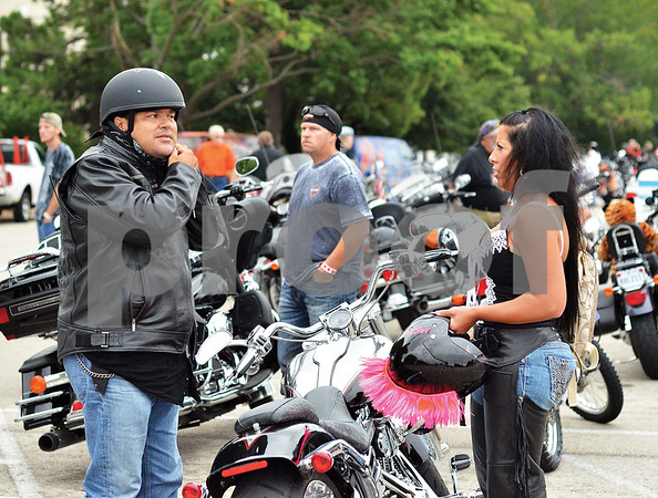Richard and Casie Harris, of Lindale, arrive at the Broadway Square Mall parking lot prior to the event. (Victor Texcucano)