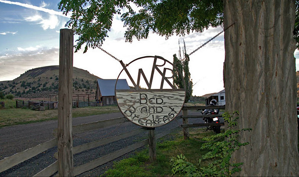 WR Ranch sign - this ranch is a 18,000 acre working ranch in Fossil -  East central Oregon. Phil and Nancy Wilson run it and have a fantastic Bed & Breakfast that will sleep up to 16 people. They have a map inside of where their guests are from - All over the world , even Siberia!