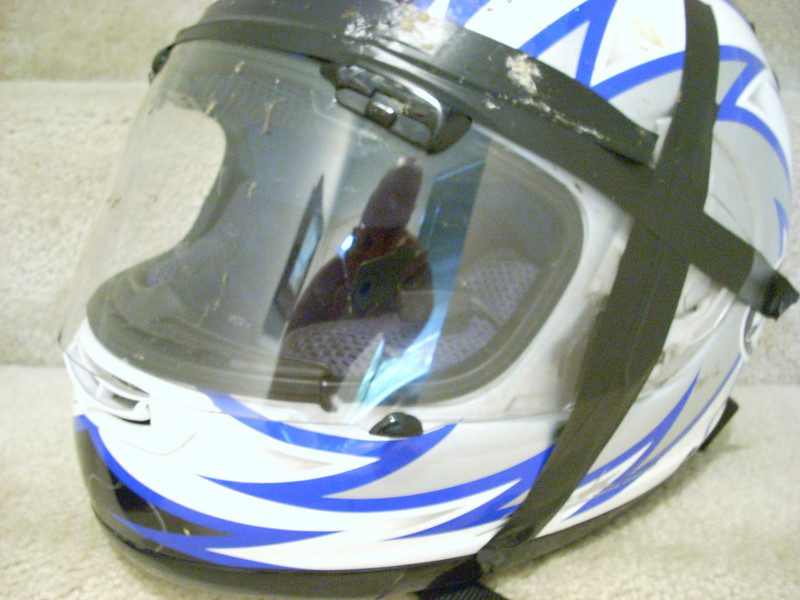 I stopped in Alvarado Texas at dusk to change to a clear visor, only problem was I brought a SHOEI visor instead of an ARAI  !    I went ahead and pulled off the ARAI tinited visor and hastily taped on the clear SHOEI, I still had 200+ miles to get home...