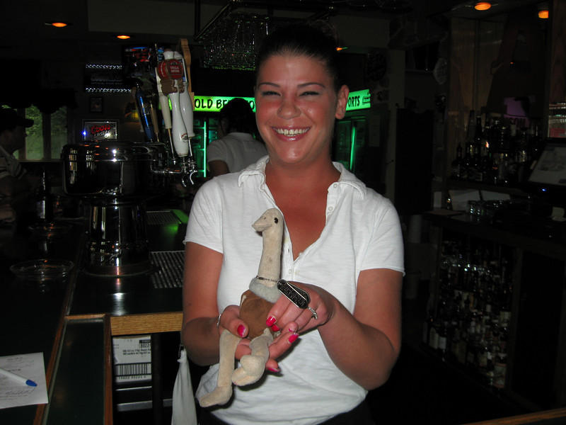 The barmaid was too shy to pose with Pooie and called in her understudy.