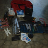 Tool role, tire repair kit, spare parts.