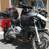 Right tank pannier contains rain gear. Gas tank and trench shovel mounted to passenger peg. Pak on top of right allumium pannier contains kitchen (stove, fuel, coffee maker). Allumium pannier contains clothes sleeping bag, extra blanket.