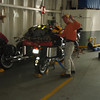 Mike getting his bike secured in the car hold of the ferry.