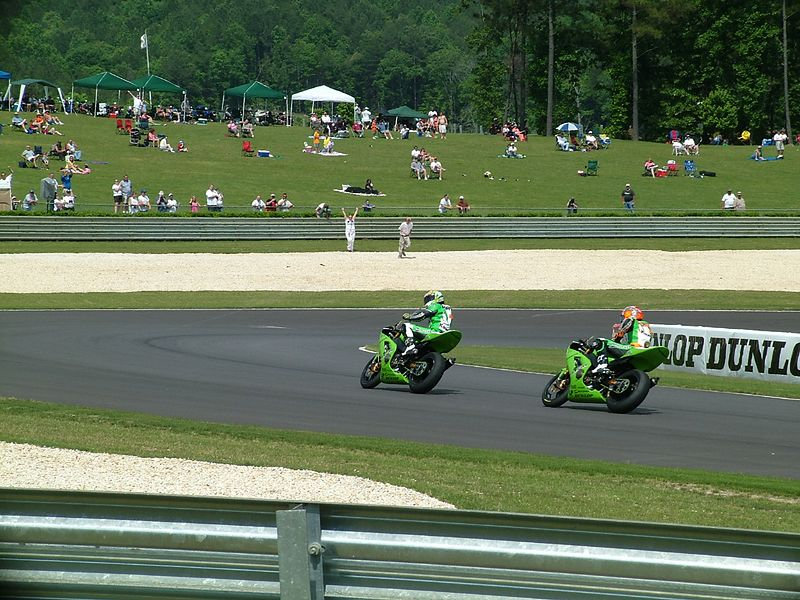 Roger Lee pumps his fist, celebrating his first professional roadrace win in the AMA 600 Supersport class.