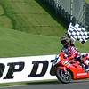 Miguel Duhamel, aboard his American Honda CBR1000RR, celebrates his 28th career Superbike victory.