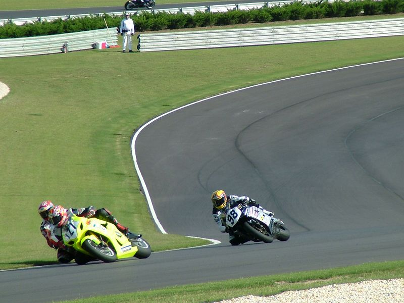 Look closely, and you'll see Superbike race leader Miguel Duhamel making a VERY tight pass on lapped rider #121. Jake Zemke, #98, follows in 2nd place.