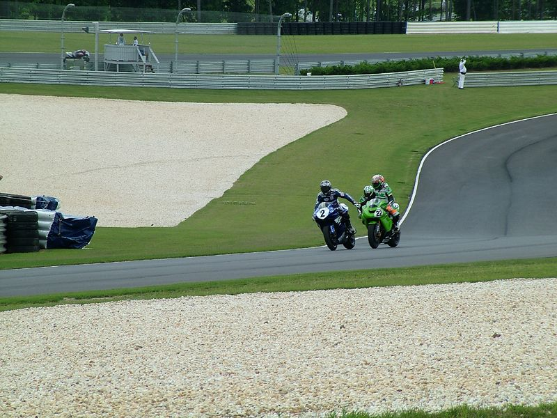 Superstock race-winner Jamie Hacking shakes hands with 2nd place Tommy Hayden.