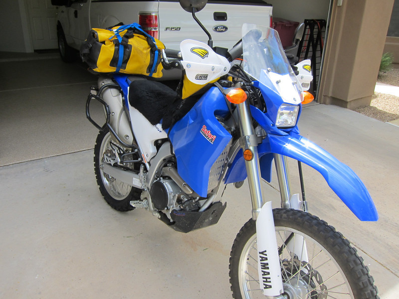 This is a small, but fully capable long distance adventure motorcycle. One cylinder of 250cc. Its main benefit is that it is only 300lbs so relatively easy to pick up in the rough after dropping it when solo. In addition it is remarkably good on the interstates. It is smooth and cruises easily at 70mph. I added a large gas tank, navigation electronics and a soft luggage system. It isn't a pure dirt bike because it is heavier and has sacrificed some dirt for broader capability, but it is relatively dirt friendly with long suspension, and small size.