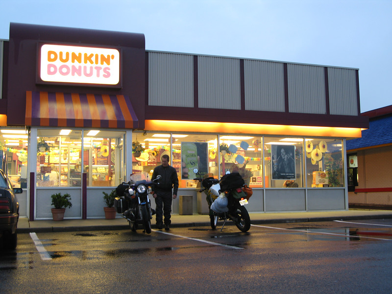 Getting ready to depart for annual Adirondak Pilgrimage,  Bill admires the classic Germanic styling of the timeless Airhead machine.    <br /> <br /> B.T.W.  This is departing from the Dunkin' Donuts on Stelton, Rd. in Piscataway.  The coffee was absoulutly lousy, and when it was brought to the attention of the people at the counter they just looked at me with these vacant stares.....Perhaps they didnt' understand English.  <br /> <br /> We will not be back to this D.D.  !