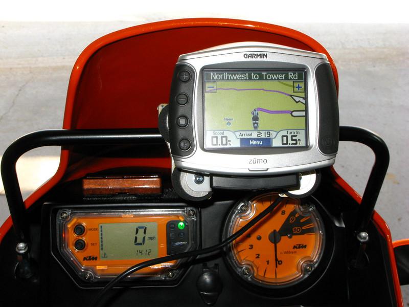 Cockpit view: Garmin Zumo GPS mounted to Tourtech MVG mount and a KTM roadbook bracket.
