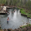 Liard Hotsprings (Lower Pool).<br /> Challenge is to set a rock on the wall of the boiling water outlet. The guy closest is trying.