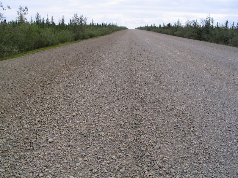 Scene of the crime, loose gravel, 15 miles north of Mackenzie river.<br /> Triumph 0, Dempster 1