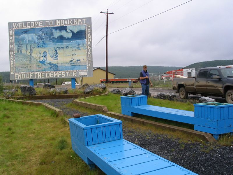 Inuvik Welcome sign, leaving w/ different wheels, and friend w/ broken wing.  Motel Inuvik campsite #14