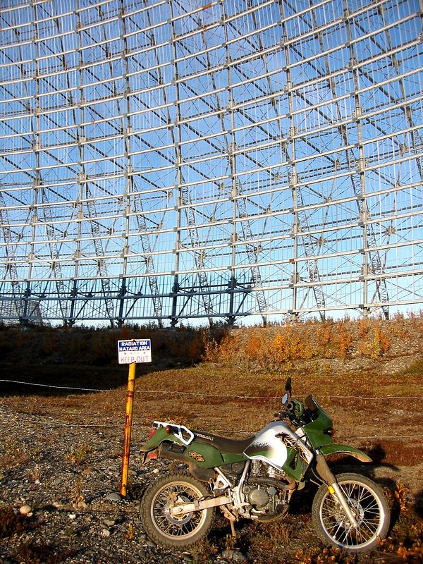 In front of one of the abandoned screens of the BMEWS radar site.  The last functioning mechanical radar to be taken off line in 2001.