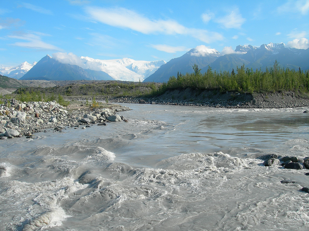 Looking up river towards the Wrangell Mountains, the Wrangell St. Elias National Park and Kennicott. It is the largest national park and home to 9 out of the 16 highest mountains in the US. All are dormant volcanoes. Access to 99.9% of the park is on foot.