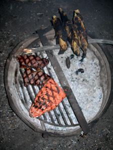 Finger lickin' good - steak, salmon and corn over the campfire.