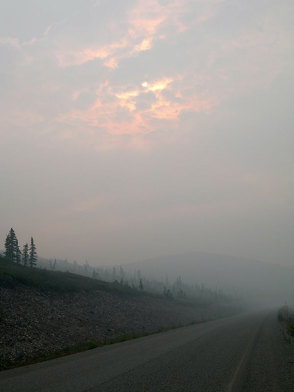 On the Top of the World Highway. The road quickly climbed above the low cloud, which was quickly replaced with smoke from the many fires caused by lightning strikes. In 2004 alone, 6.5 million acres burned in Alaska, during one of the driest summers in history.