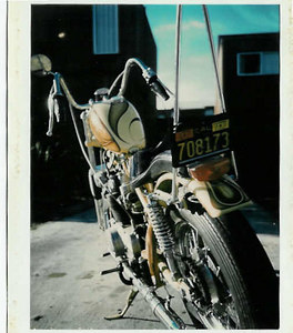 """Honda 450 Chopper. Frame was cut to drop the seat. 18"""" Harley rim was laced to the Honda rear hub. A custom peanut tank was installed in place of the stock tank."""