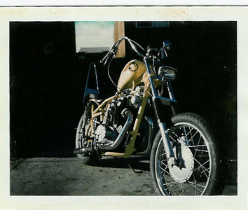 """The front end was modified with 8"""" over stock length fork tubes and a cross braced added. The frame was ground down smooth and bondo filled to make a very showy look. The wiring was hidden inside the frame."""