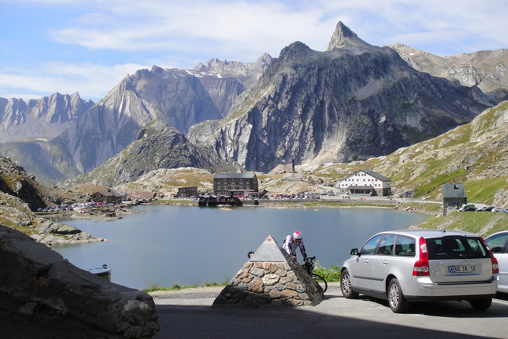 The Swiss-Italian border behind the lake, fondue in rightside building, cappuccino and pasta on the left.  Grand St Bernard Pass