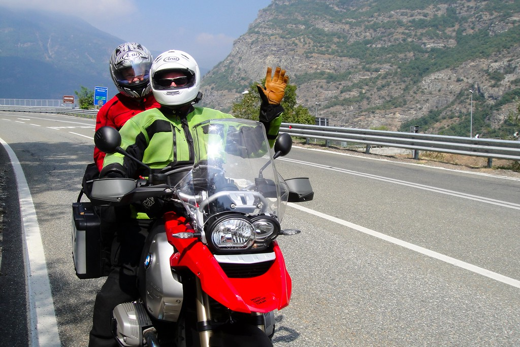A quick wave for the camera after Moto checks directions - outside Susa Italy