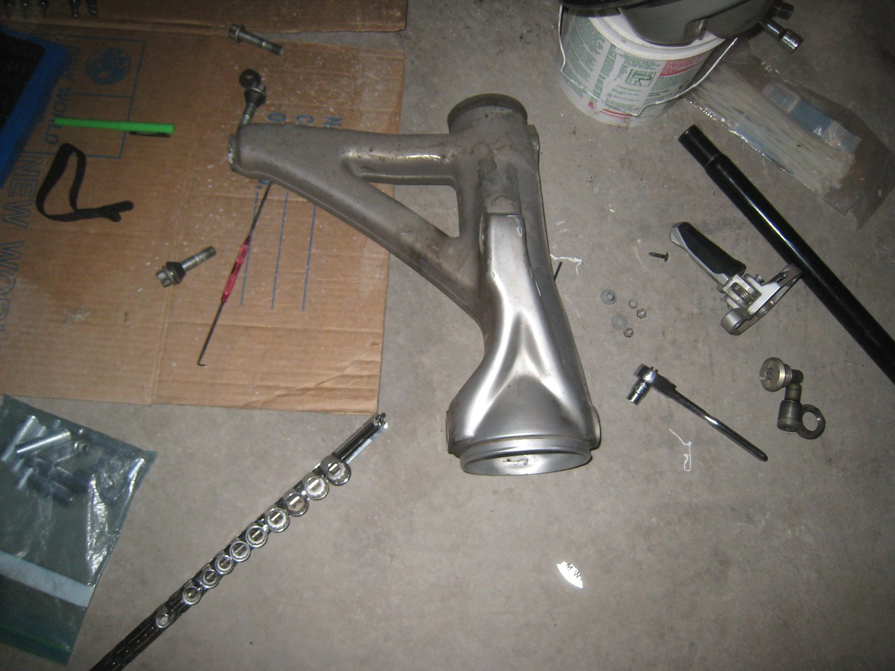 Finally, got the swing arm out.  Wait a pain in the ass.  I almost rounded off the swing arm pivot pin, breaking a socket in the process.  Thank goodness I was able to get the pivot pin out, otherwise I would really have been in trouble.  A two-foot cheater was needed to break the pin loose.