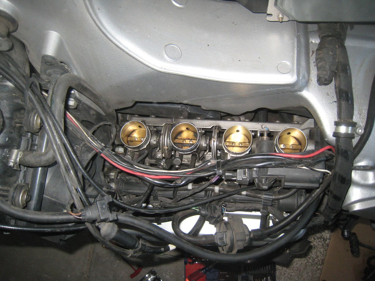 The throttle bodies got a good spritz of carb cleaner.