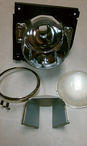 High beam reflector exploded view.