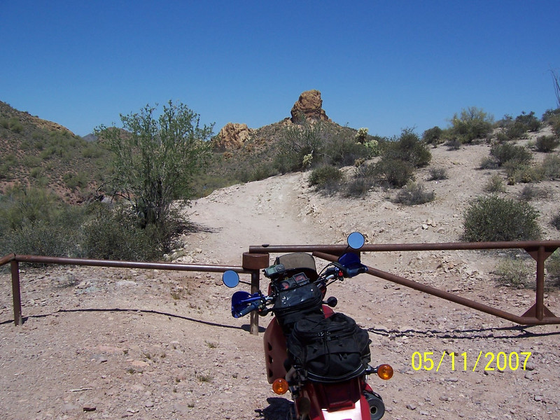 I saw place near Lost Dutchman called Bulldog Canyon OHV area, so I decided to ride into it. The gate was locked but there was an opening for hikers and a motorcycle could also fit through. I think the rock formation in the background is Bulldog Rock.