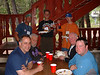 Meal time at the lodge. Back row- Glenn, Mike, Sr., and Mike, Jr.  Seated, L to R- Dave, Corky, Wayne, and unknown.