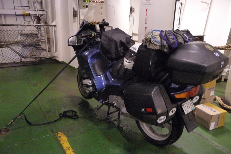 I rode on down and took the long bridge over to Prince Edward Island, but about the time I got on the island, it started raining and settled in thick, so I bailed out and took the ferry over to NS.  Here I am all tied down for the ride.