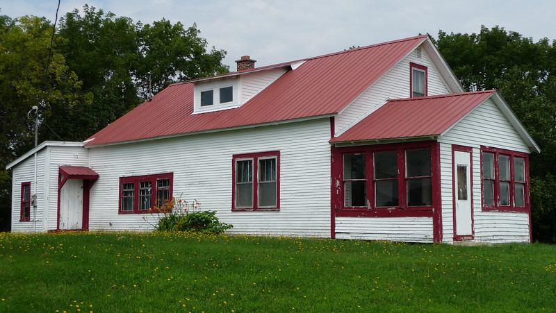 The adjoining farmhouse that went with the barn...dandelions rule!