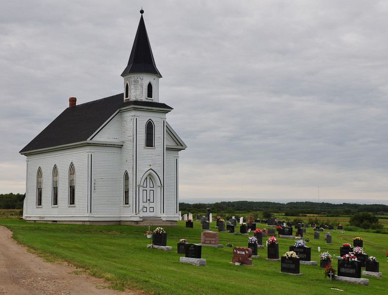 Starting out Monday morning, I ran along the Eastern Coast of New Brunswick, next to the Gulf of St. Lawrence, lots of houses and farms along the shore.  Naturally lots of small churches along the way.  This one stood out.