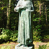 I believe a statue of Saint John...at the edge of the woods near the St John's in the Wilderness Episcopal Church.