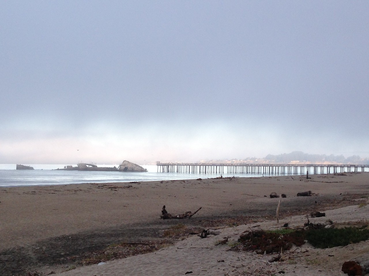 The iconic Aptos pier and its busted-up old shipwreck. Aptos is cloudy while Santa Cruz, in the distance, is always sunny, just because.