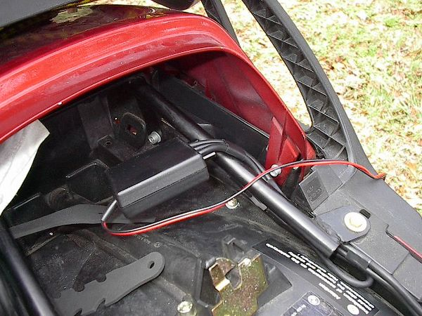 taped rider/passenger cables together, taped-back 2-way radio plug.  ( I won't use this feature...yet)
