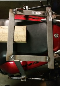 "The frame is constructed of 1 1/4"" flat iron and connects to my existing side and top case brackets."