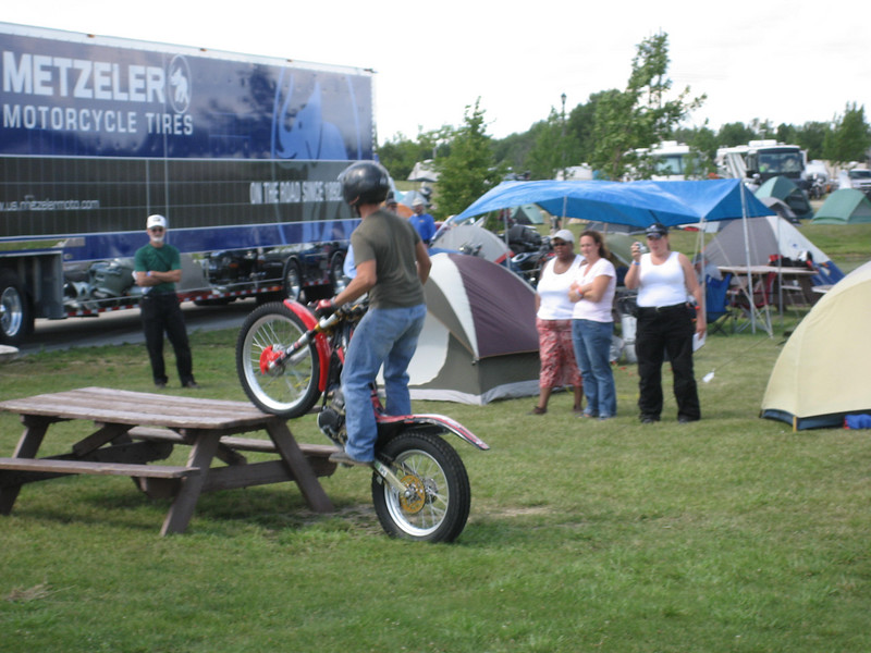some guy doing a little trials-riding demonstration