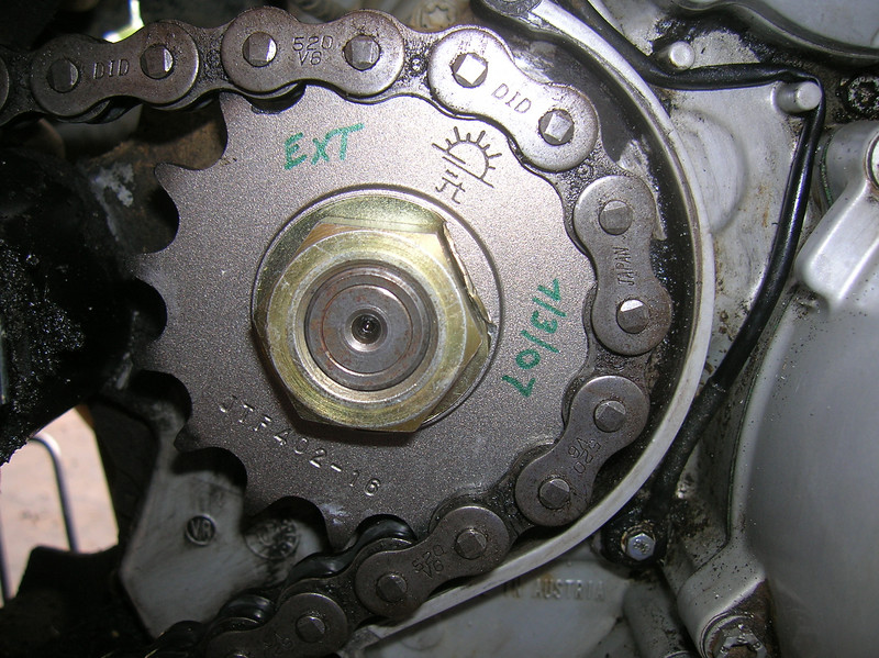 New sprockets & chain at 12K miles.  Old chain shown in photo.