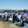 These are rental tents,  upon arrival your tent is waiting along with sleeping bag, chair and towel each morning.