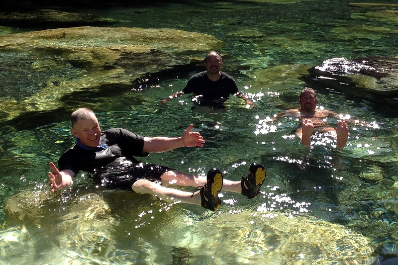 "Steve Irby , Chad Yoshitomi and Tad Haas enjoy a cool dip in one of the ""Three Pools"" by Jeanne Pike"