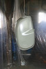 Primer coat goes on fuel tank.  Plastic sheet is used to create temporary dust free paint booth.